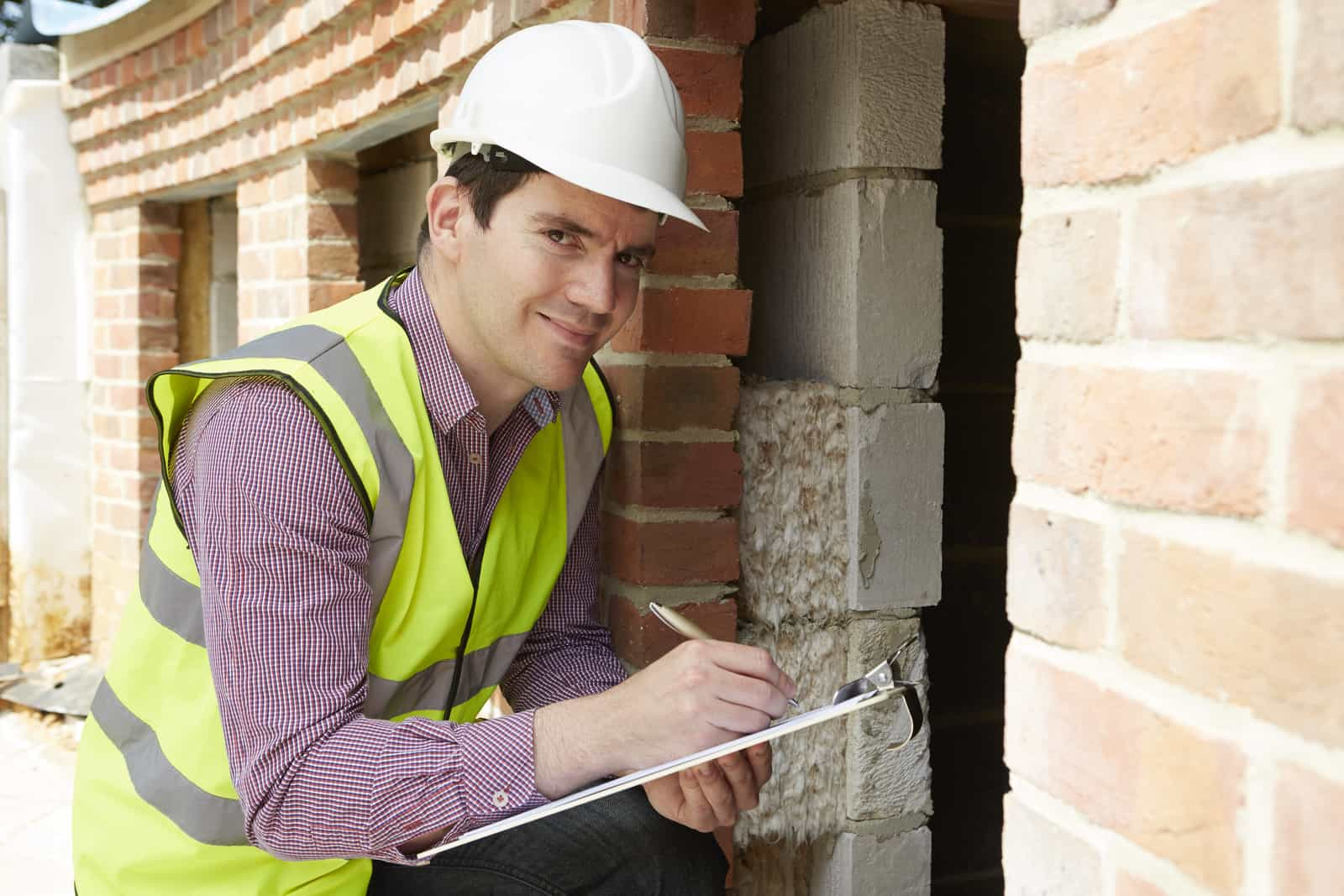 32329636_architect-checking-insulation-during-house-construction