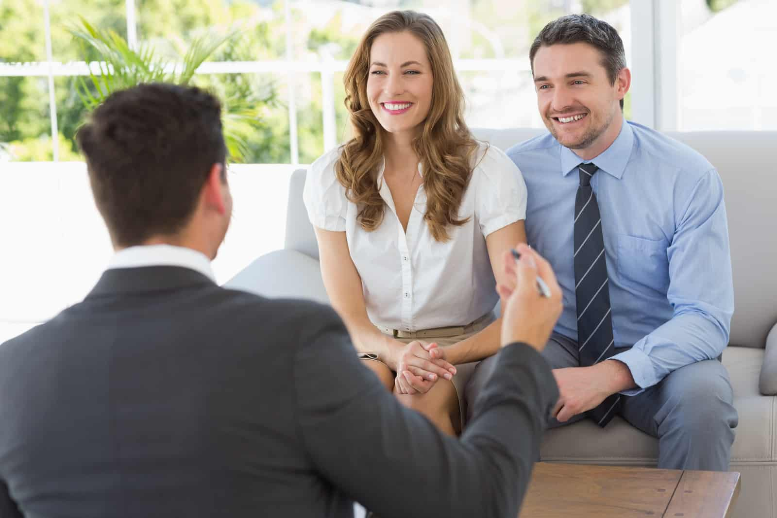 smiling-couple-in-meeting-with-a-financial-adviser-2